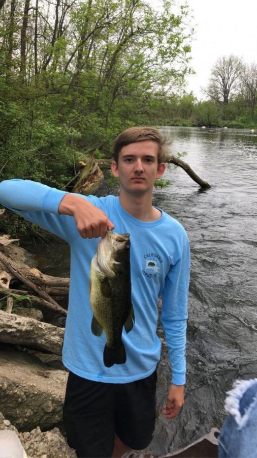 Connor Blaney (12) at Dunkirk Dam holding a newly-caught large mouth bass. Photo from Connor Blaney.