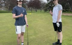 Beck Sisler (11) and Zack Bonebright (11) pose at the Stoughton Country Club. Photo from Beck Sisler.