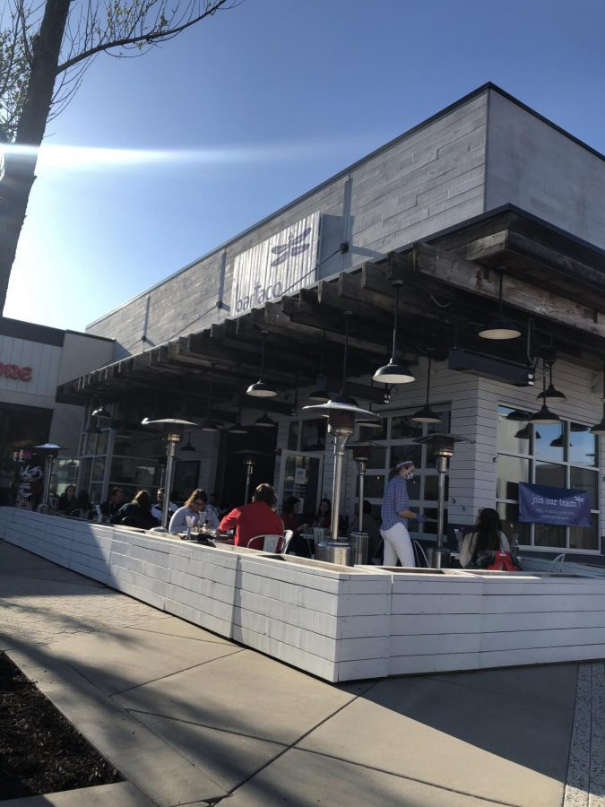 Bartaco's outdoor patio glows while the sun begins to set.