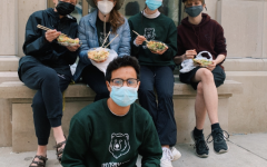 Norse Star seniors in a Madison alley enjoying their poke bowls.