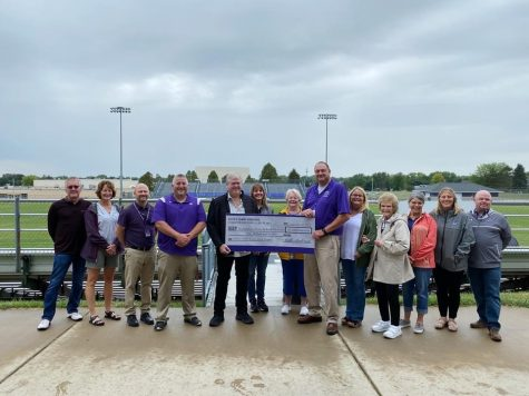 Keith and Tammy Anderson present a check for $1,000,000 to representatives of the Stoughton School District and Stoughton Sports Boosters club.