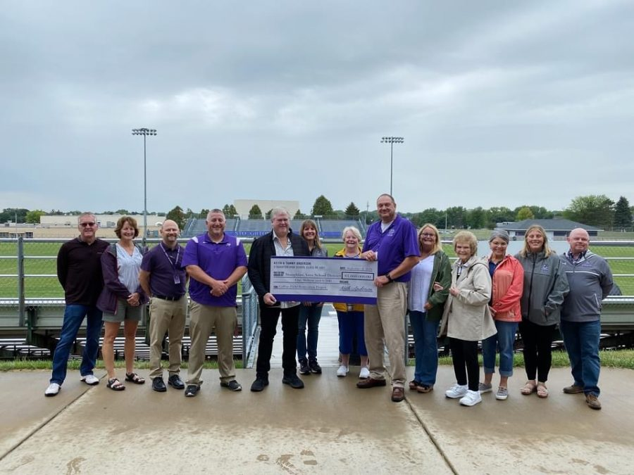 Keith+and+Tammy+Anderson+present+a+check+for+%241%2C000%2C000+to+representatives+of+the+Stoughton+School+District+and+Stoughton+Sports+Boosters+club.