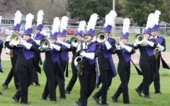 Viking Marching band warms up before performing their 2019 field show